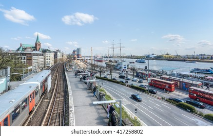 Hamburg, Germany - May 01, 2016: HDR of Landungsbruecken in Hamburg with Elbphiharmonie on a sunny day with nautical vessels and traffic.