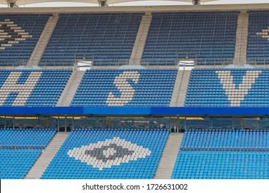 Hamburg, Germany - May 09, 2020: Empty grandstand in the Volkspark Stadium from the Soccer Club Hamburger SV, Ghost games in a football stadium in the corona time