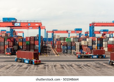 Hamburg, Germany - May 10, 2011: An autonomous driving straddle carrier is serving containers in the Altenwerder Container Terminal in Hamburg, one of the most modern terminals in the world, serving 2