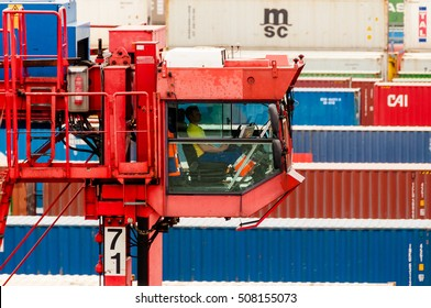 Hamburg, Germany - May 10, 2011: A straddle carrier is serving containers at the Buchardkai Container Terminal in Hamburg.