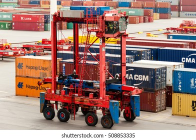 Hamburg, Germany - May 10, 2011: A straddle carrier is waiting to pick up containers unloaded from a container ship at the Buchardkai Container Terminal in Hamburg.