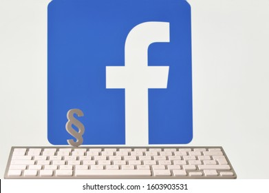 Hamburg / Germany - May 10, 2018: Paragraph sign in front of the facebook logo symbolizes the problems with data protection and data security