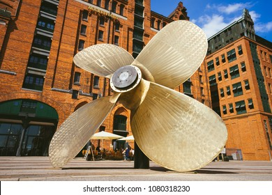 Hamburg, Germany - May 17, 2018: Giant four-blade ship propeller in front of the International Maritime Museum in Hamburg's Speicherstadt district