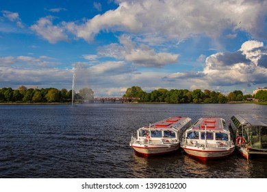 HAMBURG, GERMANY - May 2019: Boats on the Alster Lake in Hamburg in the central historical district Roterbaum of Hamburg, Germany. Sunny day in Hamburg.