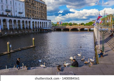 HAMBURG, GERMANY - May 2019: People near the  Alster Lake in Hamburg in the central historical district Roterbaum of Hamburg, Germany. Sunny day in Hamburg.