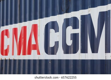 "HAMBURG, GERMANY - MAY 21, 2017: Shipping container of the French container transportation and shipping company ""CMA CGM"" at the Port of Hamburg"