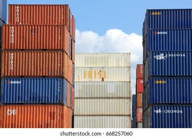 HAMBURG, GERMANY - MAY 21, 2017: Stacked varicolored shipping containers at a storage yard at the Port of Hamburg
