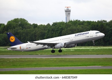 HAMBURG, GERMANY - MAY 25, 2017: Lufthansa Airbus A321 passenger plane with special Die Maus sticker taking off from Hamburg Airport.