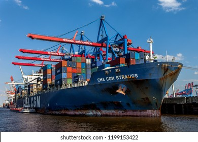 Hamburg, Germany - May 26, 2011: A container ship is being loaded by gantry cranes at a dock in Hamburg Harbour. Port of Hamburg is the largest port in Germany.