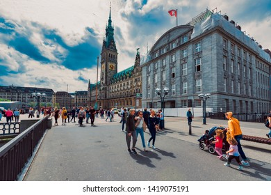 HAMBURG, GERMANY - May 31, 2019: Unidentified pedestrants cross the market place in front of the city townhall