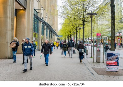 Hamburg, Germany - May 5, 2017:  People Walking along Moenckebergstrasse on a Spring Day. Moenckebergstrasse is probably the best-known and most used and visited shopping street in Hamburg.