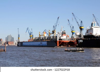 HAMBURG, GERMANY - MAY 5, 2018: Blohm+Voss Shipyard with floating dock 10 and Elbe Philharmonic Hall (Elbphilharmonie) in the background
