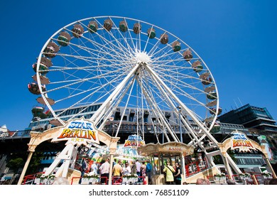 HAMBURG, GERMANY - MAY 7: Ferris wheel on the fair at the Hamburg Harbour Birthday Festival on May 7, 2011 in Hamburg, Germany.