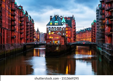 Hamburg, Germany. Night view of Speicherstadt in Hamburg, Germany. Illuminated historical buildings at sunset with reflection in the water