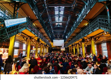 Hamburg, Germany - November 11, 2018: Altona Fish Market inside the market hall with unidentified people. The fish market is today one of the main tourist attractions in Hamburg