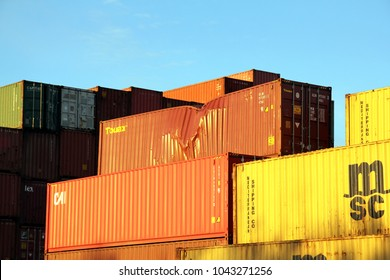 HAMBURG, GERMANY - NOVEMBER 13, 2017: Shipping containers stacked at the Port of Hamburg. The Touax container among them being damaged.
