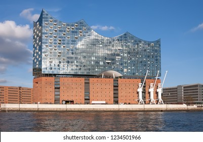 Hamburg, Germany - November 3, 2018: View of Elbphilarmonie (Elbe Philharmonic), a concert hall in the Hafen City quarter of Hamburg and river Elbe.