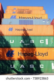 HAMBURG, GERMANY - OCTOBER 1, 2017: Shipping containers of HAPAG-LLOYD and UASC stacked at the Port of Hamburg, symbolizing the merger of the two companies that was completed in 2017
