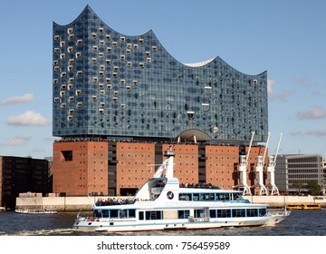 HAMBURG, GERMANY - OCTOBER 1, 2017:  Elbe Philharmonic Hall (Elbphilharmonie) seen from South West with ships passing in front of it