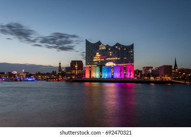 Hamburg, Germany, Panorama of the Harbour at night. With the colored illuminated music hall at Christopher Street Day