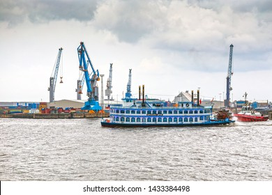 Hamburg, Germany - September 23, 2018:  Hamburg harbor, parade with various ships. View to Hamburg harbor with harbor cranes.