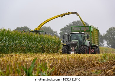 Hamburg, Germany - September 30, 2020: FENDT 930 Vario tractor with Joskin Silospace silage wagon and John Deere 8800i maize chopper during the maize harvest