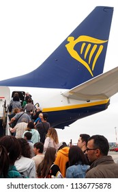 Hamburg, Germany-26th June, 2018: people boarding on Ryanair aircraft at Hamburg Airport