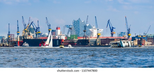 Hamburg Harbor, Germany. Cityscape with dock, cranes and the river Elbe.