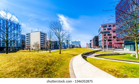 Hamburg at Sandtorpark in the harbor city with modern architecture and Elbphilharmonie in the background