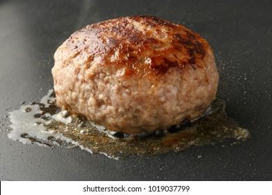 Hamburg steak during cooking