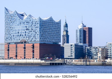Hamburg view at harbour city with St Michaelis Church and Elbe Philharmonic Hall