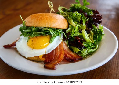 Hamburger with Bacon and Fried Egg Served with Fresh Green Salad