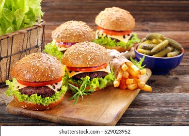 Hamburger with beef meat and fresh vegetables with empty space for text