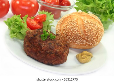 a hamburger with bread and salad