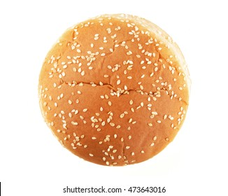 Hamburger bun with sesame seeds isolated on white background
