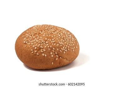 Hamburger bun with sesame seeds isolated on white background