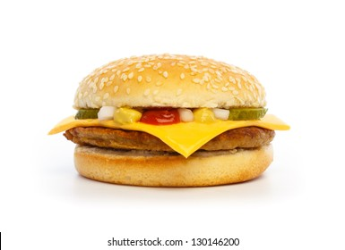 Hamburger with cheese, pickles, onion and sauce on white background