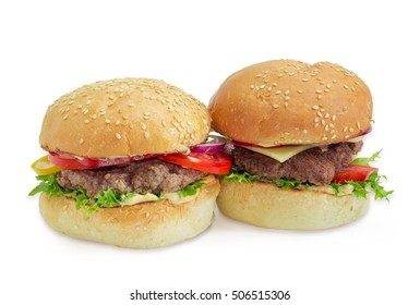 Hamburger and cheeseburger with beef patty, cheese, vegetables and condiments on a light background