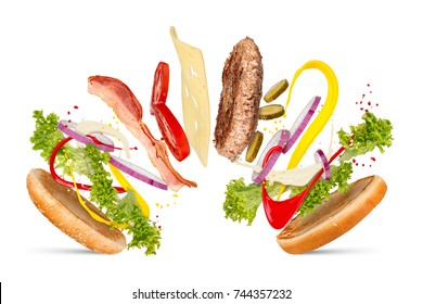 hamburger cheeseburger explosion concept flying ingredients isolated on white background