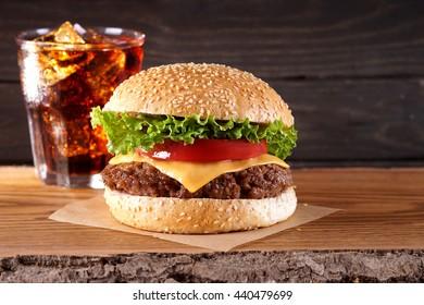 Hamburger, cola drink. Fast food, take away food.