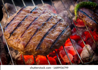 A hamburger is a food consisting of one or more cooked patties of ground meat, usually beef, placed inside a sliced bread roll or bun. The patty may be pan fried, grilled, smoked or flame broiled.
