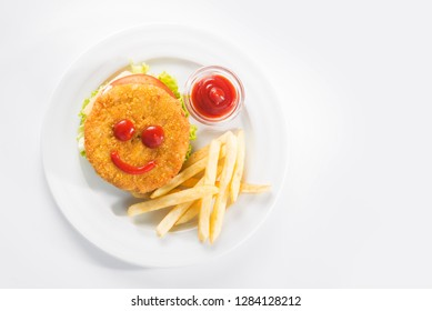 hamburger with french fries, ketchup isolated. creative food for children. funny food face. top view.