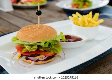 hamburger and french fries in a restaurant