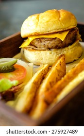 Hamburger with French Fries set on wooden , American Fast Food