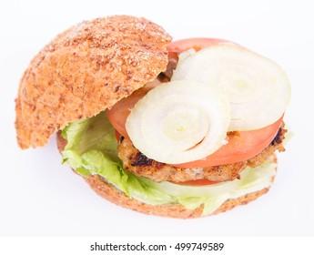 Hamburger with fresh onion, tomatoes, iceberg lettuce on a white background