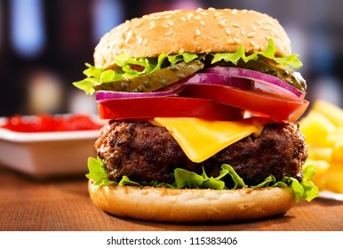 hamburger with fries on wooden table