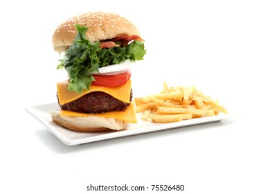 Hamburger and fries plate on white background