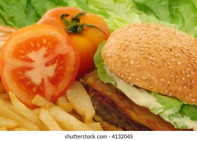 Hamburger fries tomato and lettuce composition