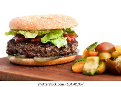Hamburger with green salad isolated on white background