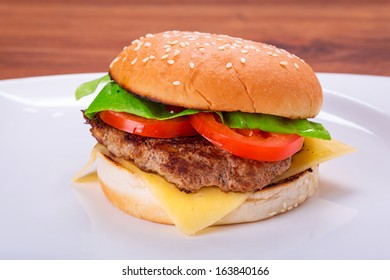 Hamburger with grilled beef, cheese and vegetables